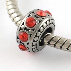 Korálek váleček s červenými kamínky chirurgická ocel (1 ks)