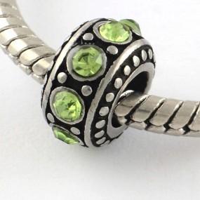 Korálek váleček se světle zelenými kamínky chirurgická ocel (1 ks)